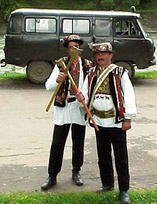 Hutsuls in folk clothes with axes